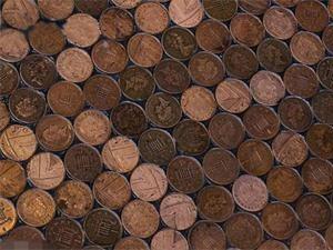 理发店用70000硬币铺地板 带动了店里面的生意