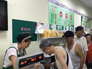 南京邮局跨界卖菜 用剩余铺面来实惠大家